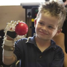 "Liam enjoys his ""bionic hand"", the product of a 3D Printer (Image courtesy of MakerBot) Source: Forbes"